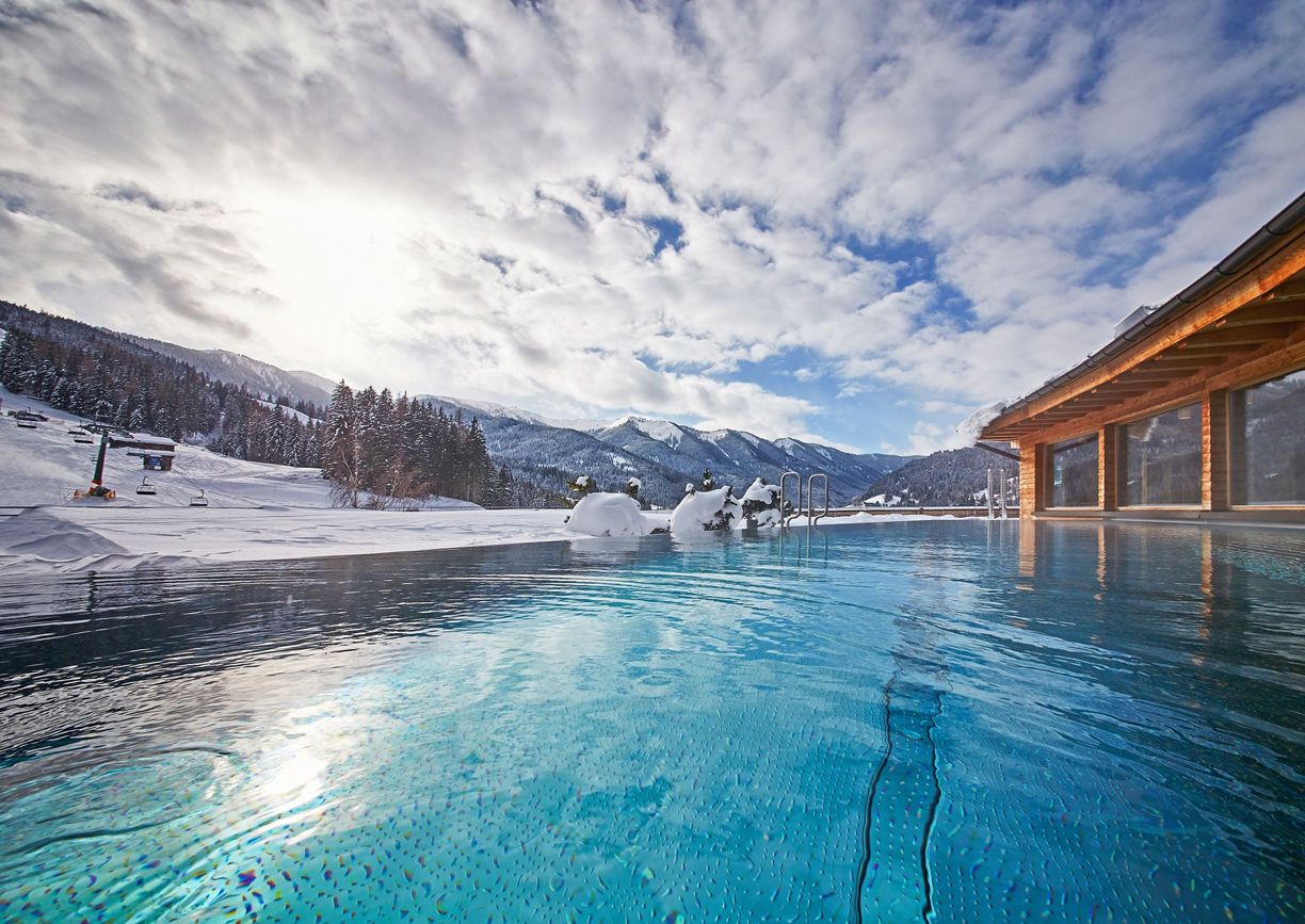 Holzhotel Forsthofalm Leogang Salzburger Land Spa Wellness Winter Rooftop Pool